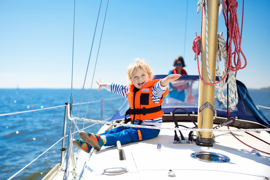 Child sailing on boat